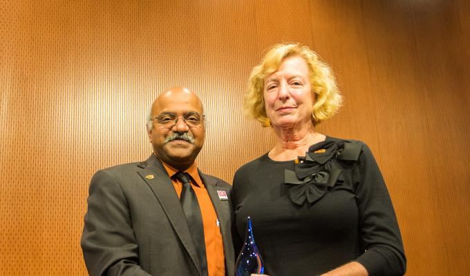 Gretchen Schuette receiving award from Sastry Pantula