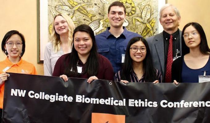 group photo of bio ethics team holding banner