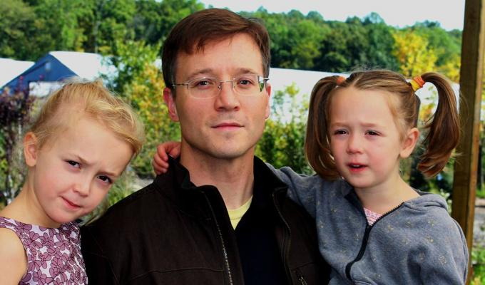 Justin Hall with his daughters in park