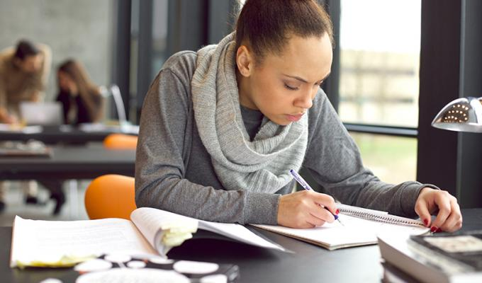 Woman working on homework at table
