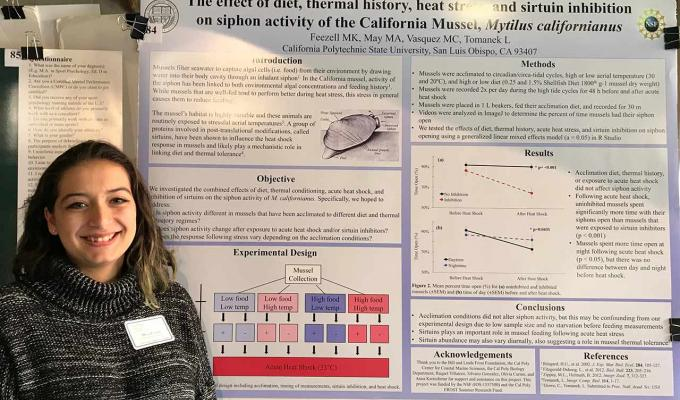 Maya Feezell standing next to her research poster