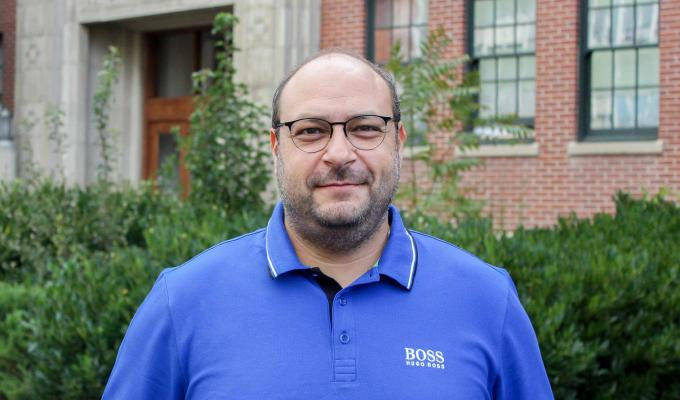 Kyriakos Stylianou standing in front of Gilbert Hall