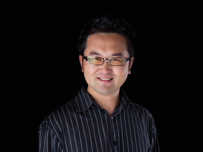David Ji in front of black backdrop