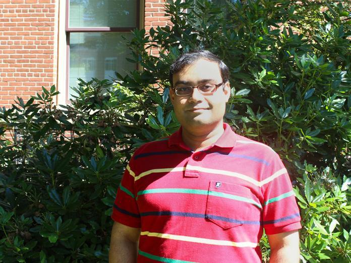 Sharmodeep Bhattacharyya standing outside Kidder Hall
