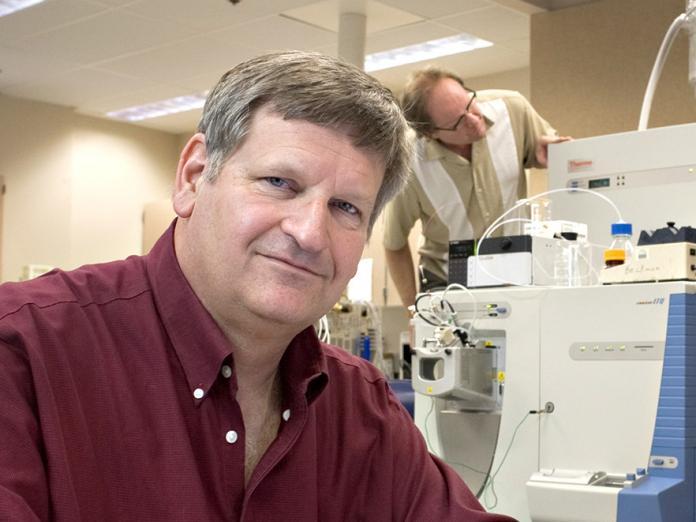 Joe Beckman sitting in lab