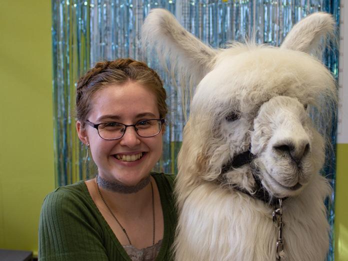 Isabella Jonson hugging a llama