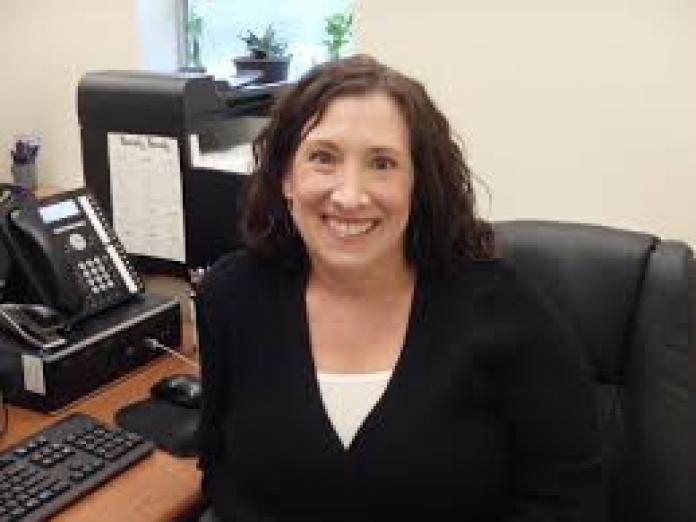 Tiffany Bolman sitting in office chair.