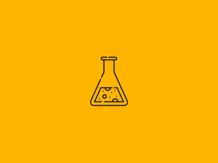 Beaker icon above yellow backdrop.
