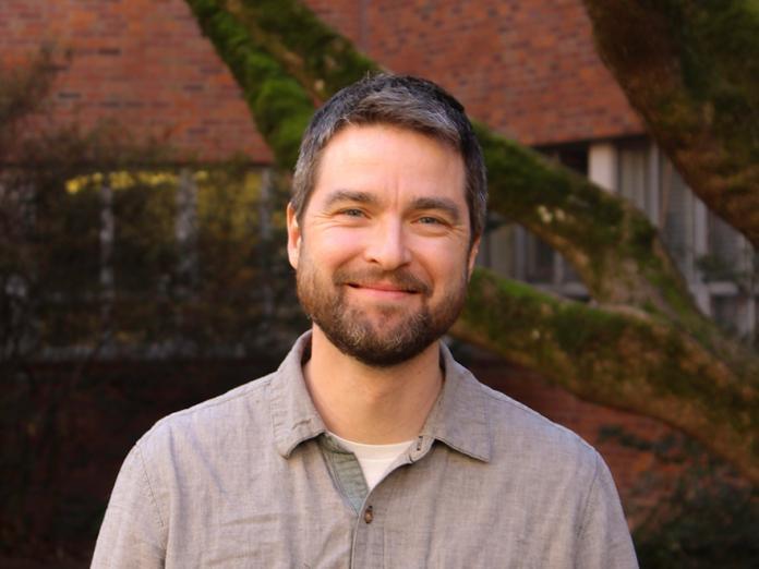 Benjamin Dalziel standing in the Cordley Hall courtyard.