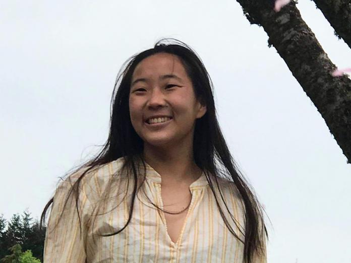 Jessica Li standing outside underneath a tree.