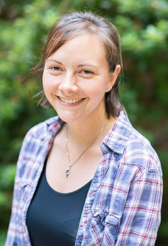 Andrea Burton in front of shrubbery