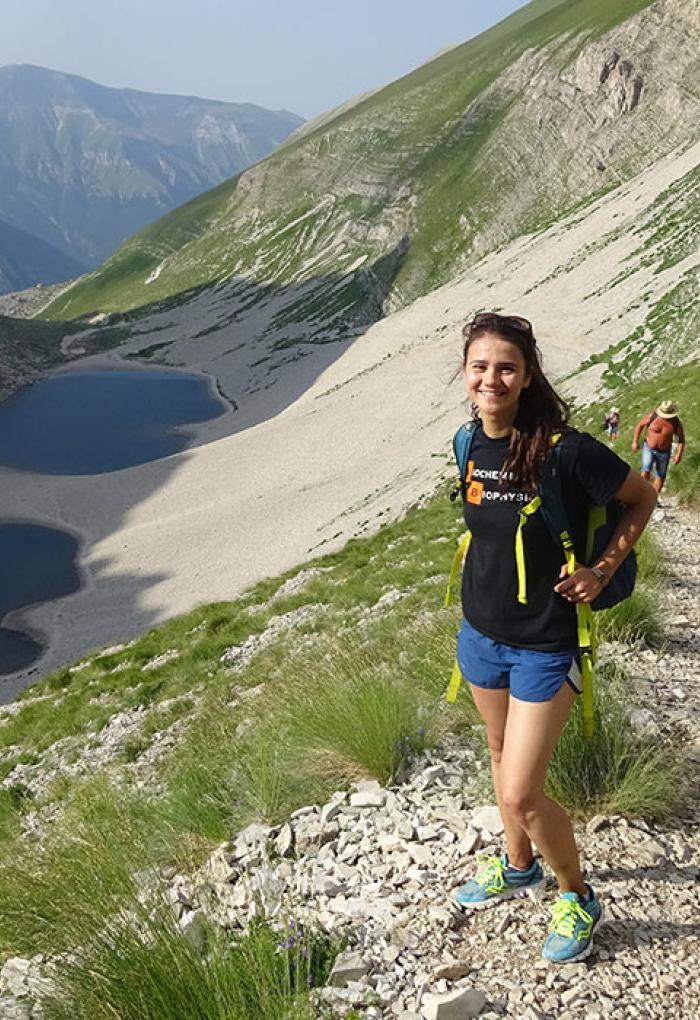 Arianna Kahler-Quesada hiking on hillside