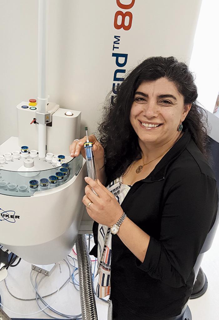 Elisar Barbar working with lab equipment