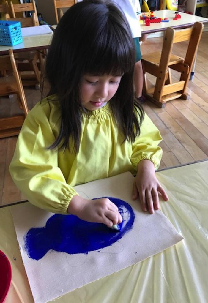 Child in soma drawing with YInMn Blue