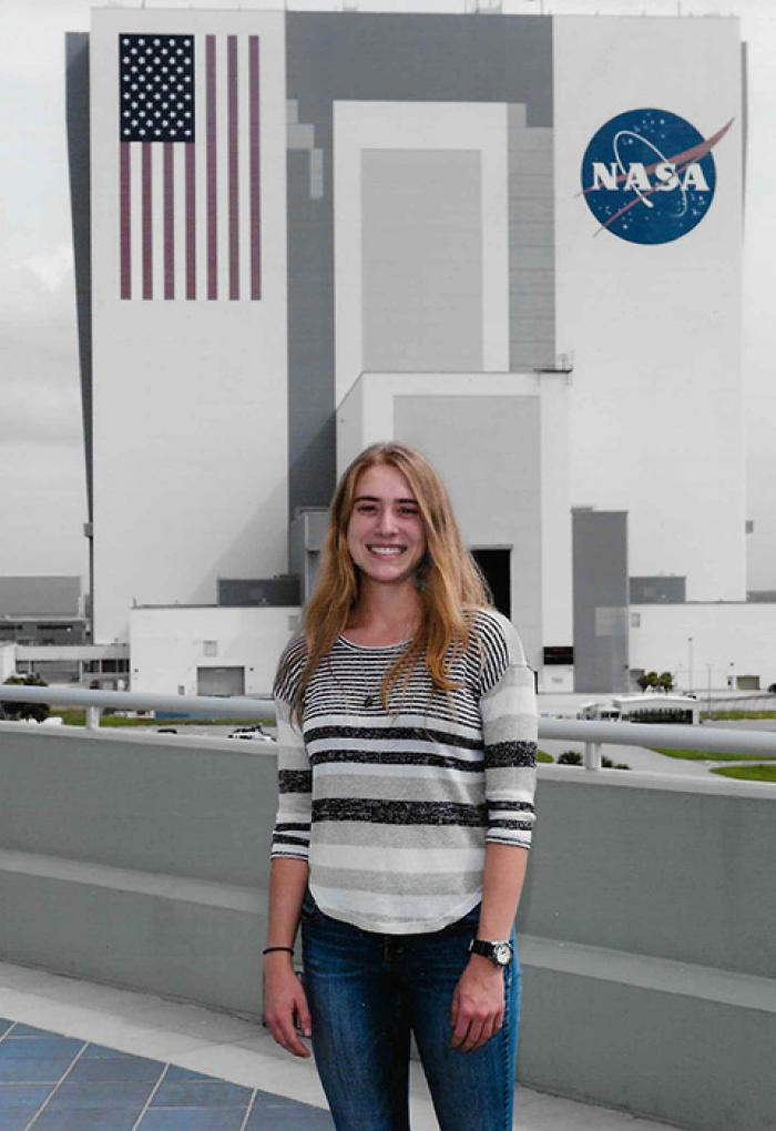 Jessica Scotten standing in front of NASA facility