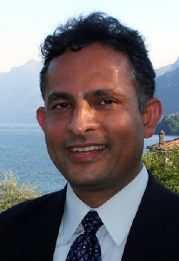 Ramesh Krishnamurthy in front of lake bay