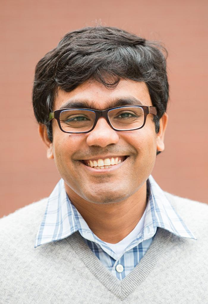 Debashis Mondal in front of brick wall