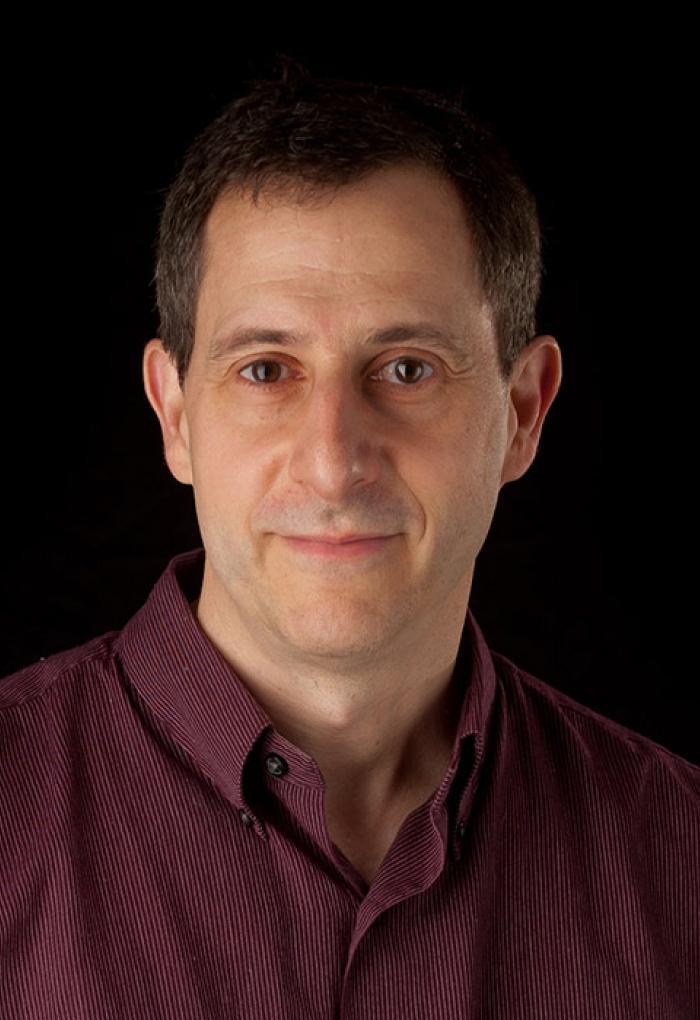 Mike Lerner in front of black backdrop