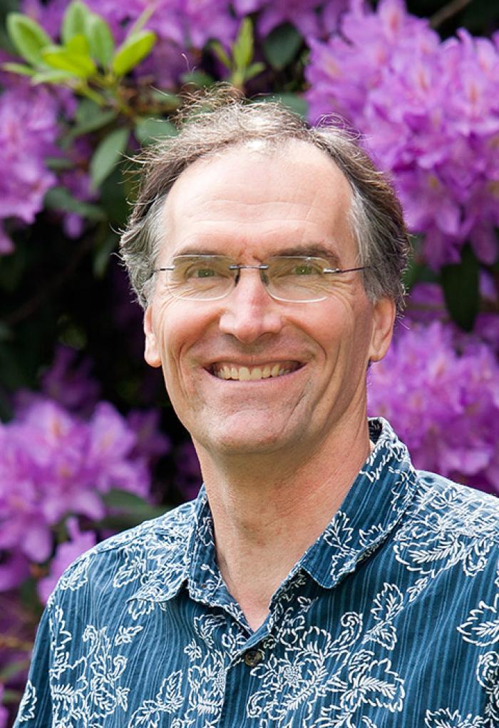 David McIntyre in front of flowery bush