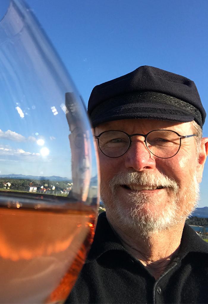 Joel Peterson taking selfie with wine glass