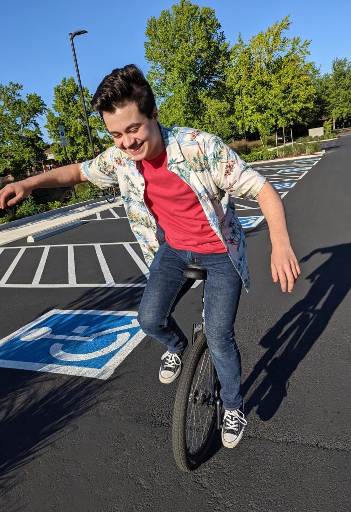 Linus Unitan enjoys riding his unicycle around campus.