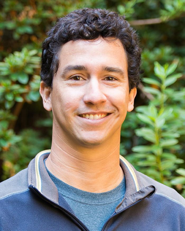 Felipe Barreto in front of shrubbery
