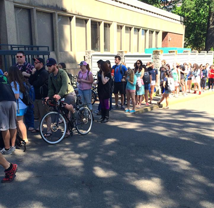 Students lined up in front of Milne Hall