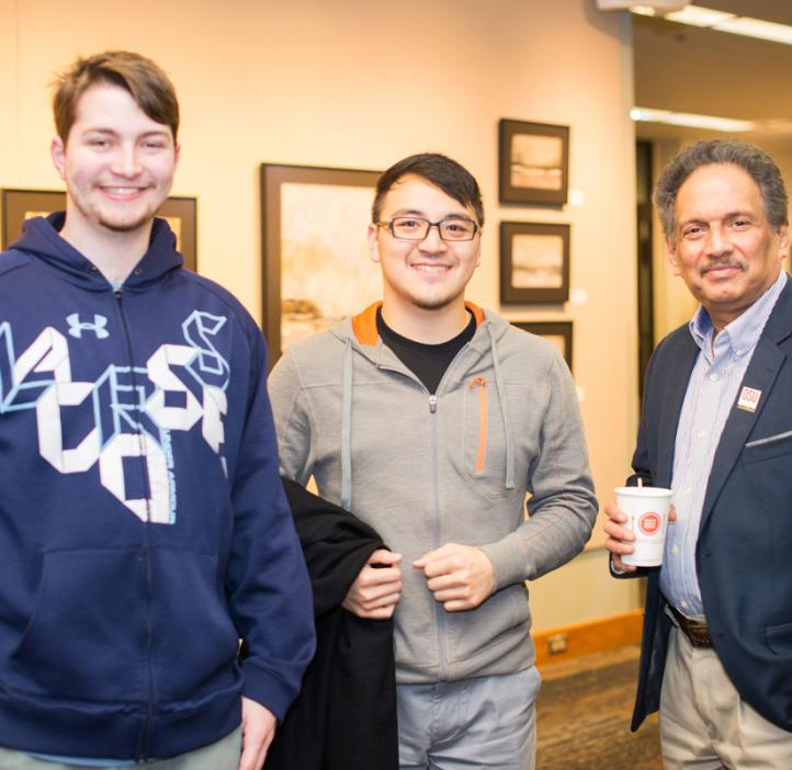 Mas Subramanian with students in lobby