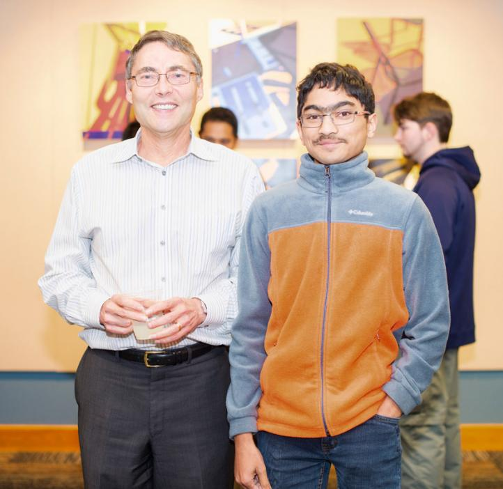 Carl Wieman with student in lobby