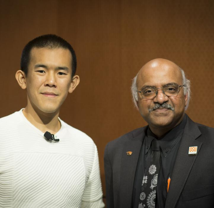 Ed Yong and Sastry Pantula in front of wood backdrop