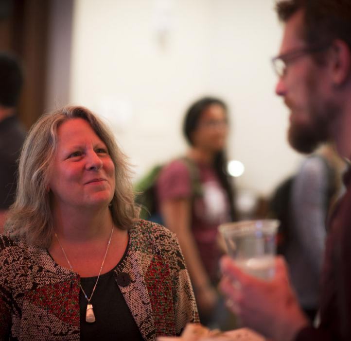 Jerri Bartholomew speaking with colleague