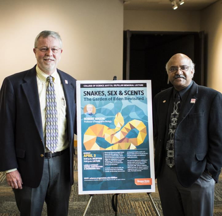 Robert Mason and Sastry Pantula next to event poster
