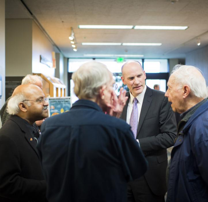 Sastry Pantula chatting with colleagues in lobby