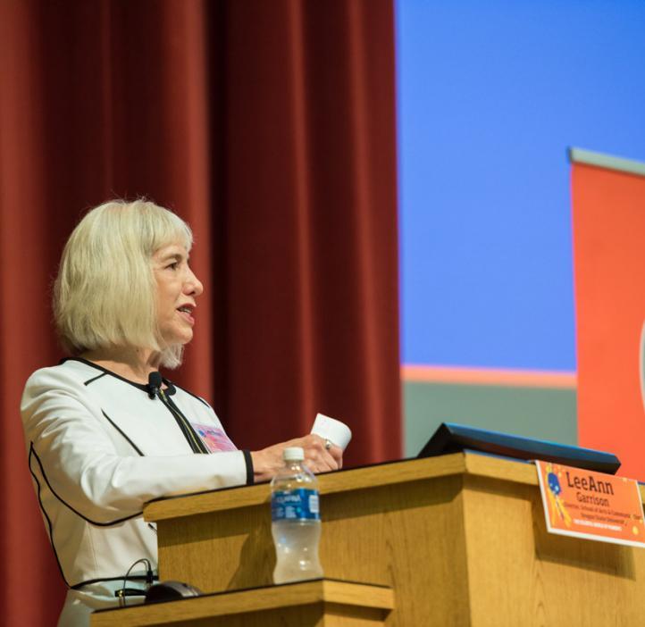 LeeAnn Garrison speaking behind podium
