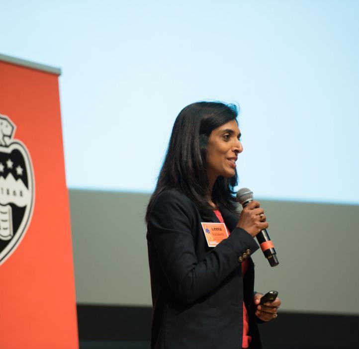 Leena Vadaketh speaking on stage