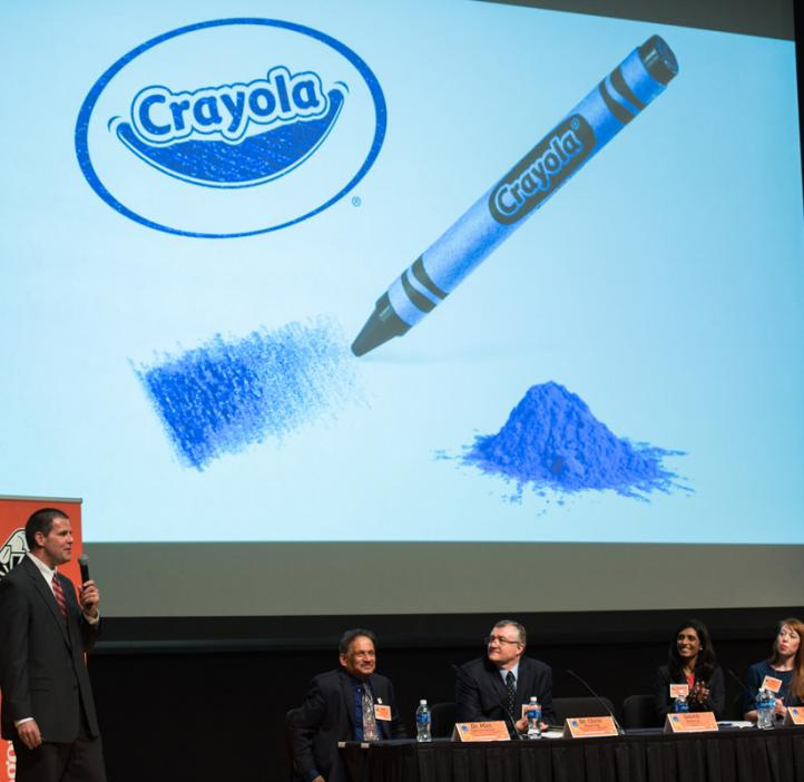Smith Holland speaking with Crayola crayon slide