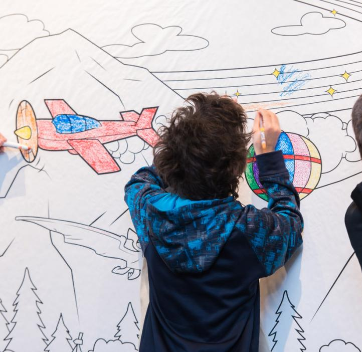 children coloring Crayola paper banner of airplanes flying