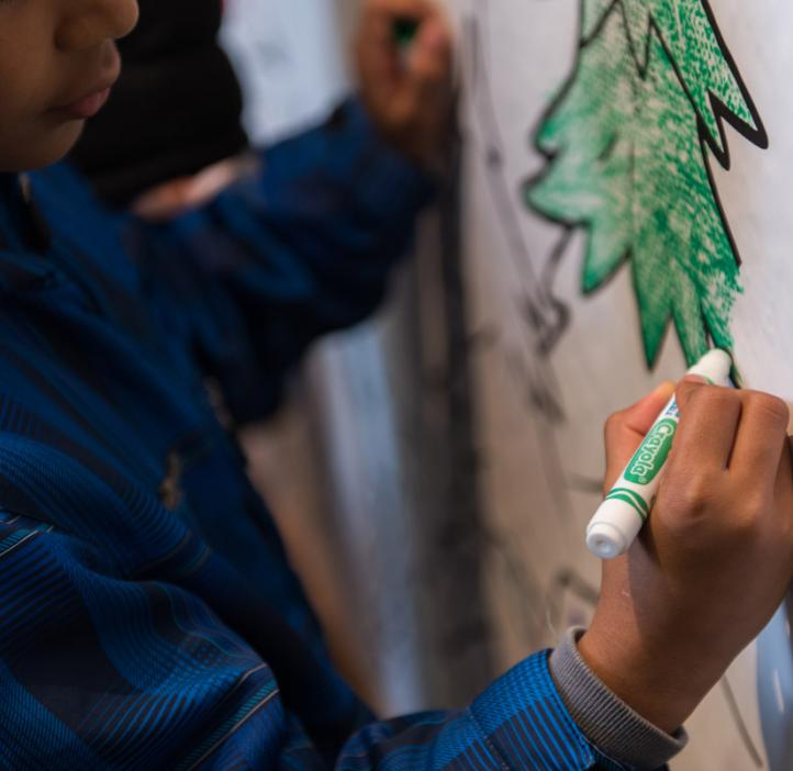 children coloring Crayola paper banner of trees