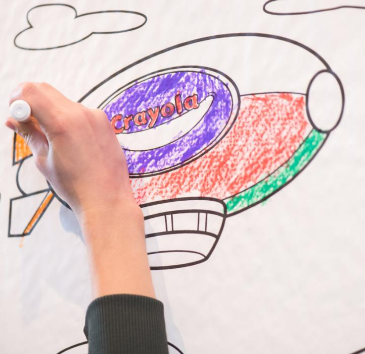 child coloring blimp on paper