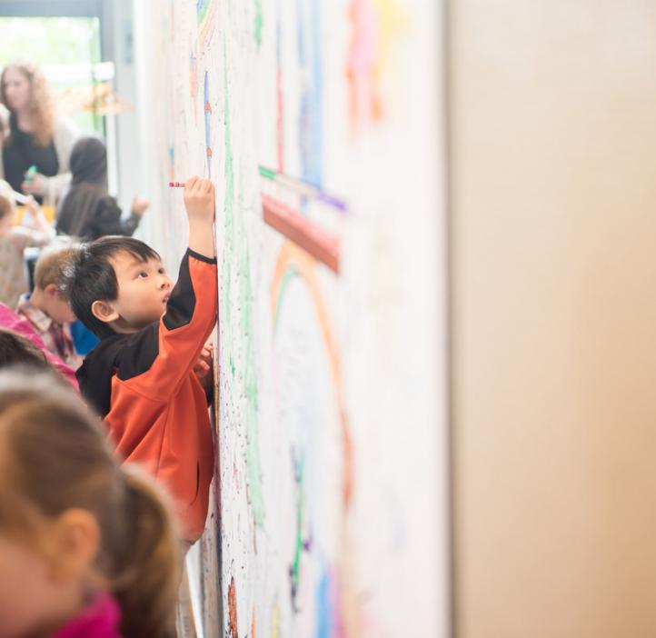 children coloring on banner