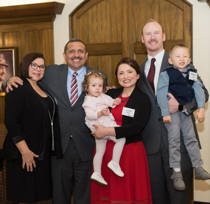 Young Alumni Award winners Luisa and Nathan Snyder with family at the 2017 College of Science Alumni Awards