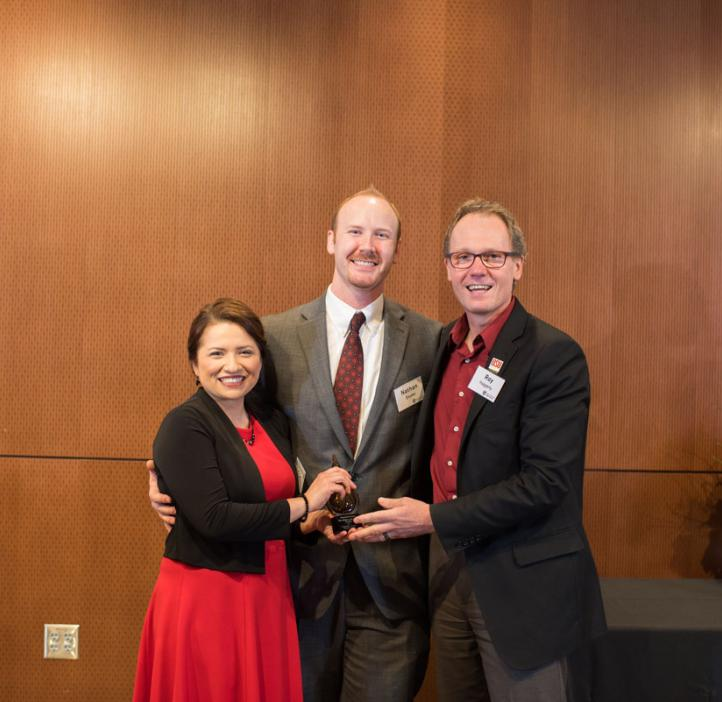 Luisa and Nathan Snyder receiving the Young Alumni Award from College of Science Dean Roy Haggerty