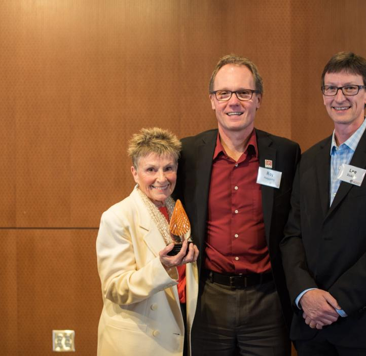 Distinguished Service Award recipients Kay Merrill and Lee Sickler with Dean Roy Haggerty (center)