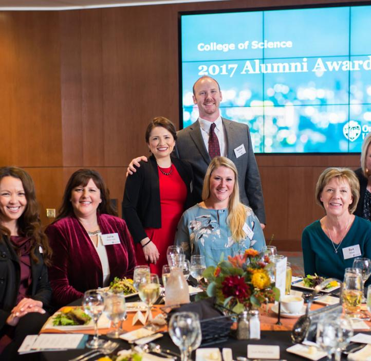 Young Alumni Award recipients Nathan and Luisa Snyder (standing)