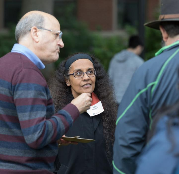 Indira Rajagopal chatting with faculty