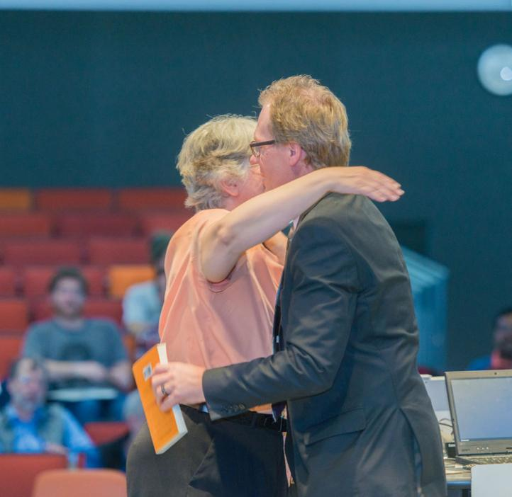 Corinne Manogue hugging Roy Haggerty on stage