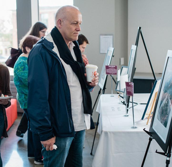 male parent checking out artwork