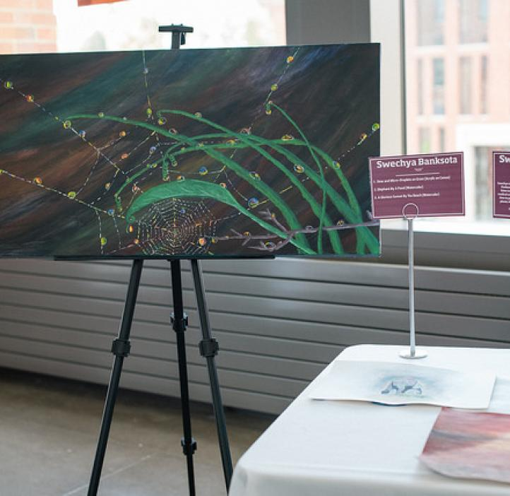 Green and spider webbed artwork on display
