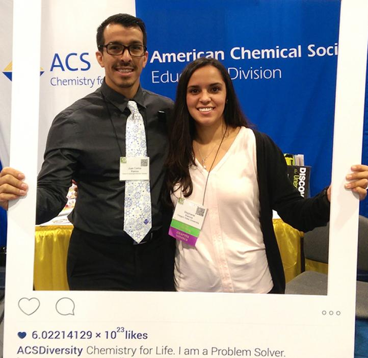 Two OSU SACNAS students holding instagram interface poster