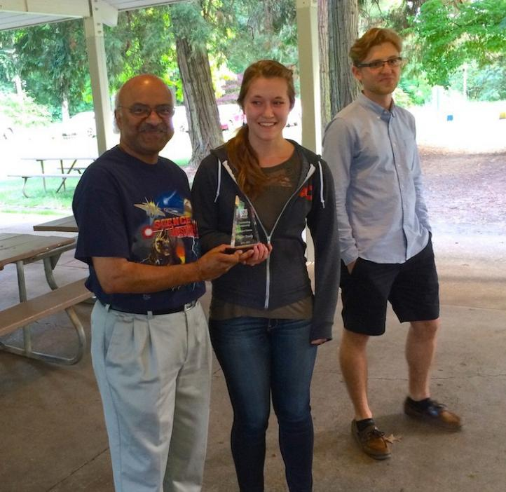 Sastry Pantula handling award to female student